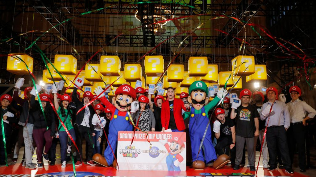People dressed as mario enjoying a contest