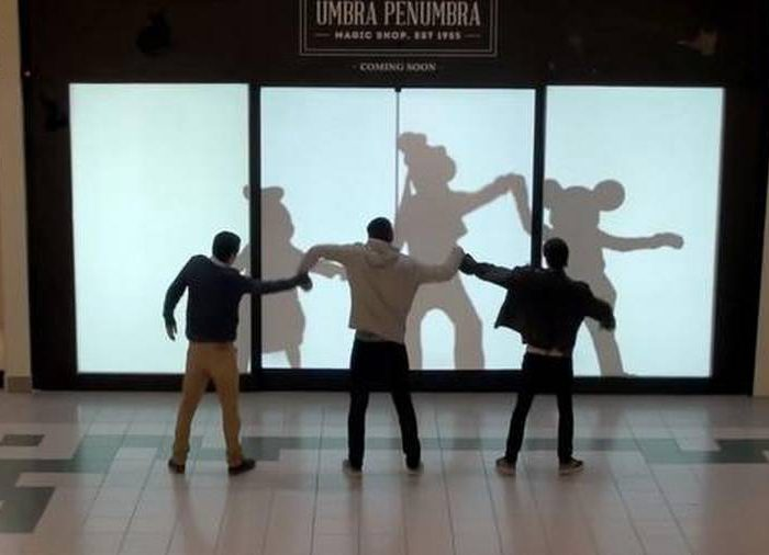 People dancing with Disney character shadows