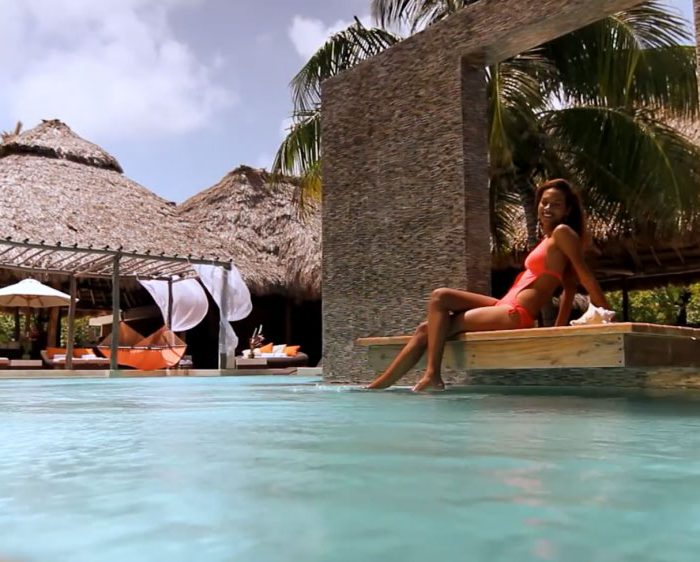 Woman relaxing at a pool in Belize