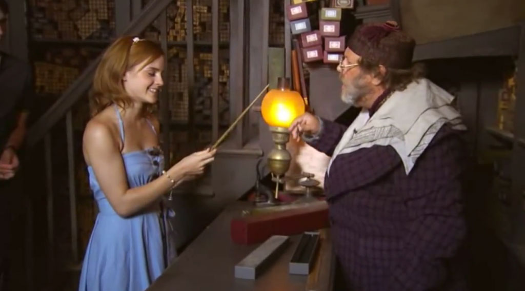 Emma Watson testing a magic wand at Universal Studios Orlando