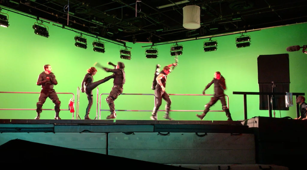 Actors fighting on a green screen