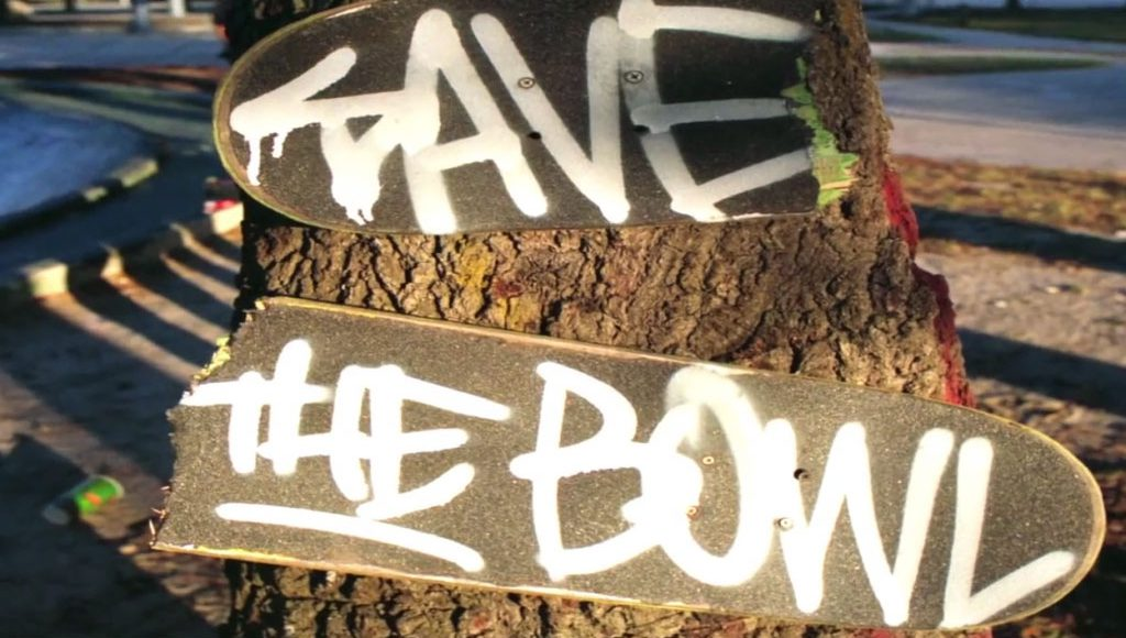 """skateboards with """"save the bowl"""" grafitti"""